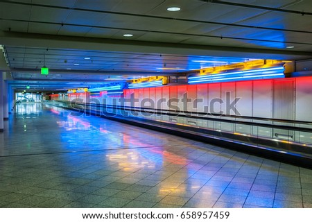 Airport speedwalk with colored lights #658957459