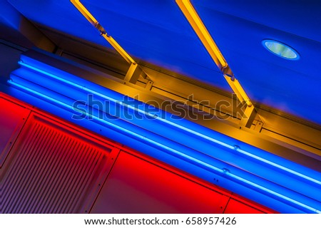 Airport speedwalk with colored neon lights #658957426