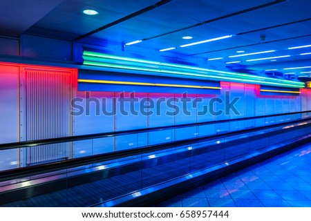 Airport speedwalk with colored neon lights #658957444