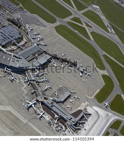 Airport - taxiways, runways, airport terminals, aircrafts, airplanes, planes and lounges in Vancouver, British Columbia, Canada - stock photo