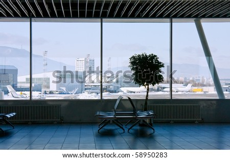 Airport terminal and view to mountain panorama from the window. International airport of Sofia, Bulgaria