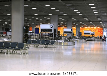 Airport terminal with baggage carousels for travelers