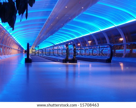 airport walkway tunnel with blue lights, manchester airport