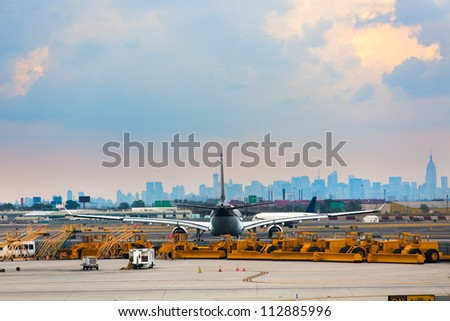 Airports runway and ground services waiting to service. With an airplane in-front of city.