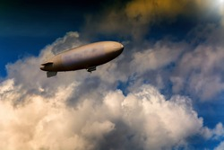 Airship, zeppelin against blue sky with dark clouds.