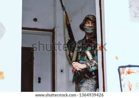 airsoft soldier reload magazine cover on wall door inside building #1364939426
