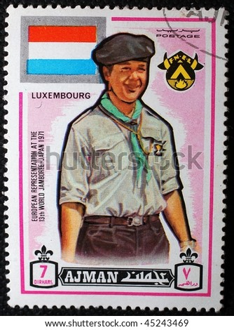 AJMAN - CIRCA 1970: A stamp printed in Ajman (now part of the United Arab Emirates) shows image commemorating the 13th World Scout Jamboree in Japan, circa 1970
