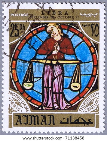 AJMAN - CIRCA 1971: A stamp printed in Ajman shows the horoscope sign of Libra, series is devoted to the frescoes in the cathedral of Notre Dame, circa 1971