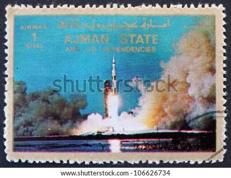 AJMAN - CIRCA 1973: a stamp printed in the Ajman shows Saturn V Rocket Launching, Moon-landing, Apollo 11, circa 1973