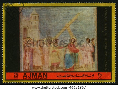 AJMAN - CIRCA 1985: Jesus Christ bears a cross, circa 1985.
