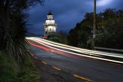 Akaroa Lighthouse with car light trails, Banks Peninsula, Canterbury, New Zealand