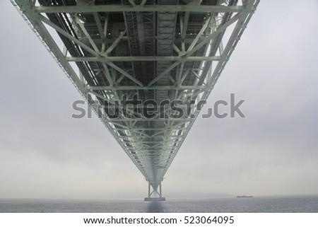 Akashi Kaikyo Bridge spans the Inland Seto Sea,the world's largest central span.Selective focus. #523064095