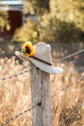 Akubra on the Barbed Wire Fence
