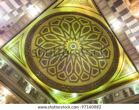 AL MADINAH, KINGDOM OF SAUDI ARABIA-FEB. 19: One of the huge domes inside of Masjid (mosque) Nabawi on February 19, 2012 in Al Madinah, S. Arabia. Nabawi mosque is the 2nd holiest mosque in Islam. - stock photo