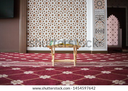 al-Quran is a holy book of Islamic guidance isolated. religion concept. An open page of Quran on wooden stand. Holy Quran in a Mosque with difference angel.  #1454597642