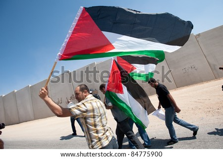 AL-WALAJA, OCCUPIED PALESTINIAN TERRITORIES - SEPTEMBER 16: Protesters march to protest the Israeli separation barrier surrounding Al-Walaja, West Bank, Sept. 16, 2011.