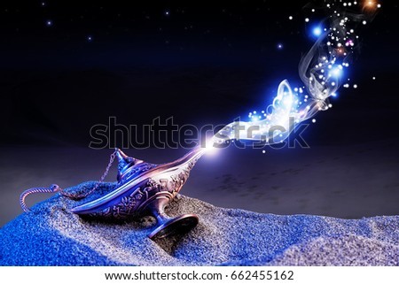 aladdin genie magic lamp on desert sand