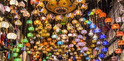Aladdin lamps or lanterns to buy as a souvenir in the gold sukh market of Dubai, United Arab Emirates. Most famous market in the city of Dubai. Dubai is famous for Gold market and spice market. Travel