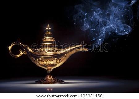 aladdin magic lamp on black with smoke