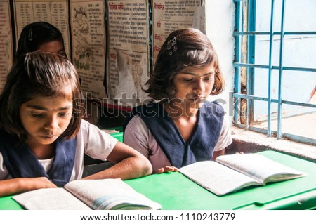 ALANGAON, MAHARASHTRA, INDIA 22FEBRUARY 2014 : Unidentified rural school student learning from books in the classroom of their school, scene of a rural or small village school in India. #1110243779