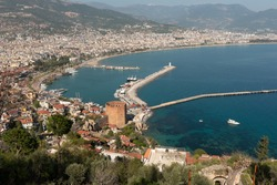 Alanya, Turkey. April 7th 2021Landscape view of Alanya Harbour and the Red Tower with the Taurus Mountains and Mediterranean sea, Turkey.