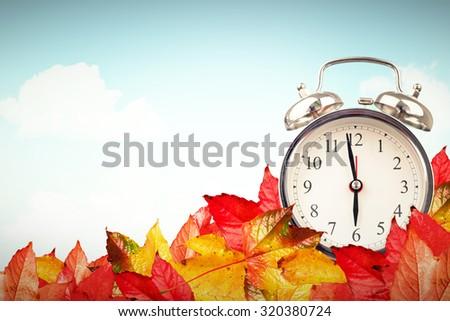 Alarm clock against blue sky