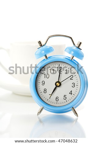Alarm clock and coffee cup isolated on white