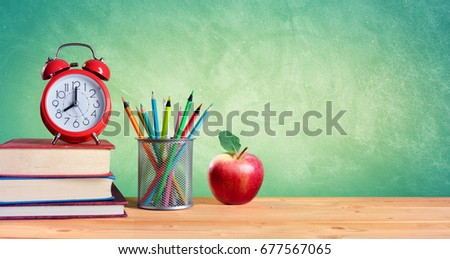 Alarm Clock And Stack Of Books With Pencils Apple