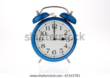 Alarm clock as a symbol of time change from summer to winter time