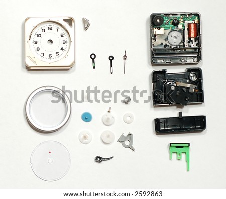 alarm clock breakout showing many plastic components