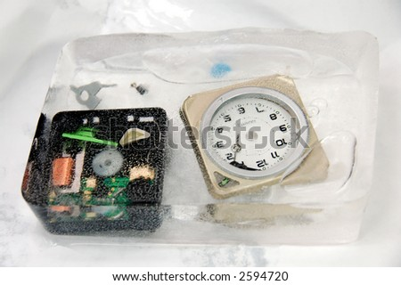 alarm clock breakout showing many plastic components  encapsulated in ice