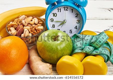 alarm clock  dumbbells and...