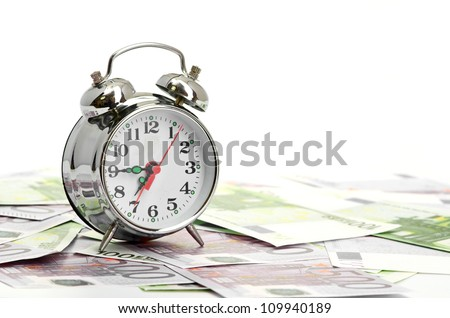 Alarm clock for euro banknotes isolated on white - stock photo