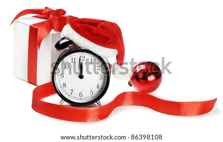 Alarm clock, gift  with Santa hat isolated on white