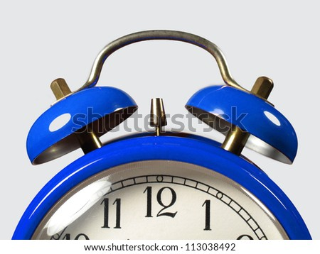 Alarm clock in the foreground