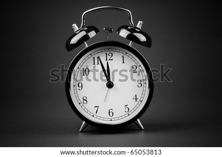 Alarm clock isolated on black