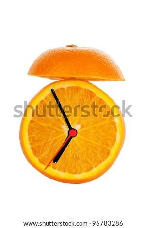 Alarm Clock made of orange fruit on the white background