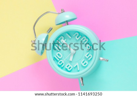 alarm clock , 8 O'Clock in the morning on pastel color background in copy space. bright color style