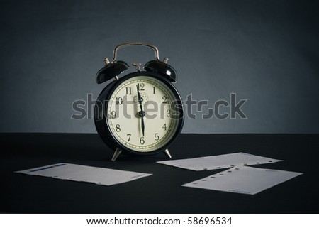 Alarm clock on a black background.