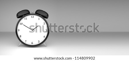 alarm clock  on a gray background - stock photo