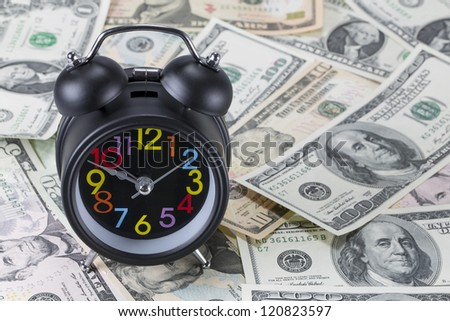 Alarm clock on banknotes