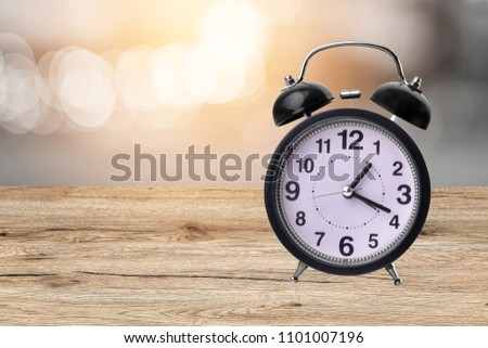 Alarm clock on the wooden floor.Blur bokeh background #1101007196