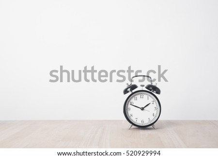 alarm clock on wood table with copy space for product display montage.