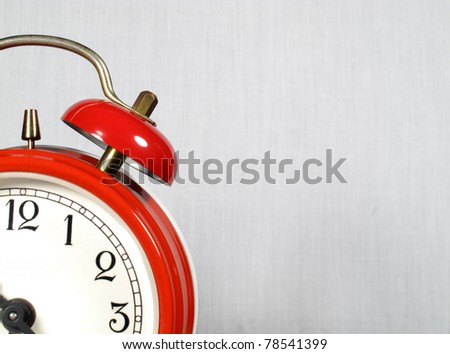 Alarm clock red in the foreground