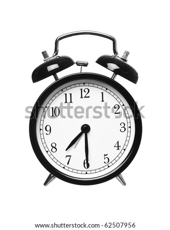 Alarm clock shows half past seven isolated on white background