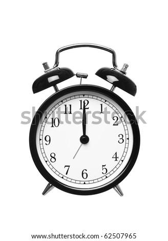 Alarm clock shows Twelve o`clock isolated on white background