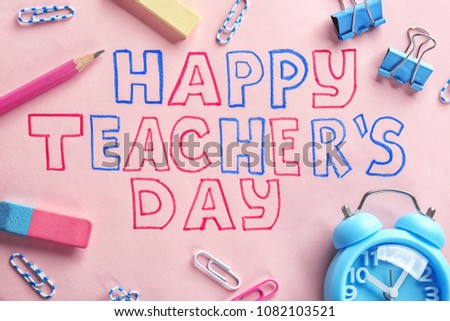 Alarm clock, text HAPPY TEACHER'S DAY and stationery on color paper - Shutterstock ID 1082103521