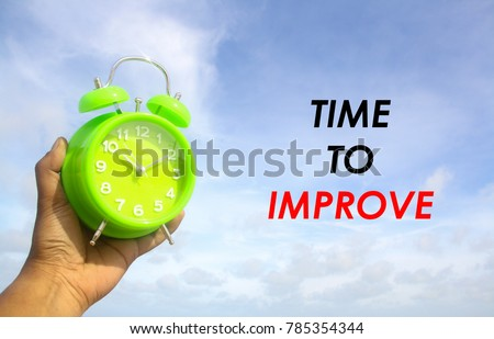 alarm clock with word time to improve over sky background #785354344