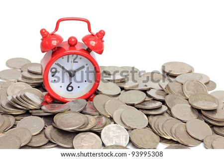 Alarm red clock with coins on white background, time is money concept - stock photo