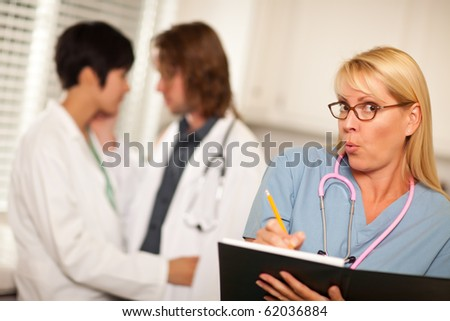Alarmed Medical Woman Witnesses Her Colleagues Inner Office Romance Display.